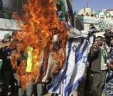 Hamas supporters burn Israeli flags; photo credit: Sydney Morning Herald