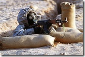 220px-Syrian_soldier_aims_an_AK-47